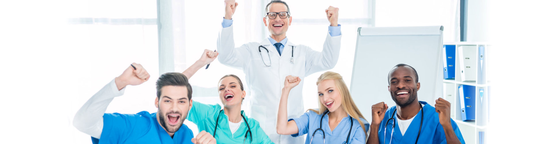 a group of medical team hands up and smiling
