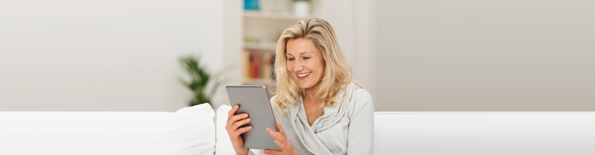 senior woman using a tablet and smiling