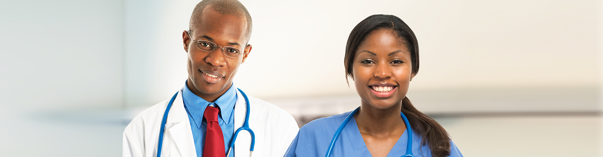 a male doctor and female nurse smiling